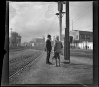 """Alexander Campbell and """"Old man"""" Smith wait for a train at Naud Junction, Los Angeles, 1900"""