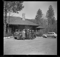Josie Shaw, Forrest Whitaker, Mertie West and Agnes Whitaker pose in front of the bike shop, Idyllwild, 1942