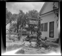 Aage V. Berg's home and sign, viewed from the side, San Jacinto, 1942