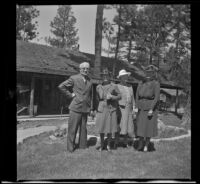 Forrest Whitaker, Mertie West, Josie Shaw and Agnes Whitaker pose outside Tahquitz Lodge, Idyllwild, [circa 1942]
