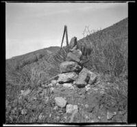 Stone monument erected to mark location of land claim, Santa Clarita vicinity, 1896