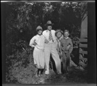 Mertie West, H. H. West, Sr., Nina Meyers and H. H. West, Jr. pose while visiting Matilija Creek, Ojai vicinity, about 1925