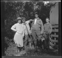 Mertie West, Nina Meyers, Glen Velzy and H. H. West, Jr. pose while visiting Matilija Creek, Ojai vicinity, about 1925
