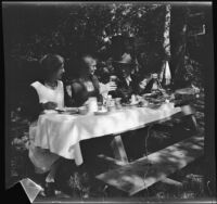 Mertie West, Agnes Whitaker and H. H. West, Sr. dine at a picnic table at Soper's Ranch, Ojai vicinity, about 1927