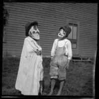 Grace and Walter Biddick dressed in costumes, Elliott vicinity, 1900