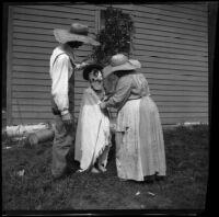 Lucy Mead and William Mead help costume Grace Biddick, Elliott vicnity, 1900
