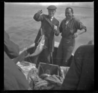 Charles Miles and Guy M. West catching fish off the coast, Santa Monica, about 1910