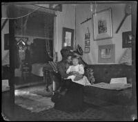 Annie M. Brain and Aileen Brain sitting on a sofa, Santa Monica, [about 1900]