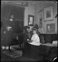 Annie M. Brain and Aileen Brain sitting in their home, Santa Monica, [about 1900]