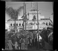 Spectators line East Colorado Avenue by Bard's Colorado Theater to watch the Rose Parade, Pasadena, 1941