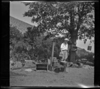 Mertie West stands at a campsite, Inyo County vicinity, about 1930