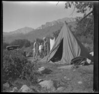 Agnes and Forrest Whitaker stand in front of Mertie West and H. H. West Jr., Inyo County, about 1930