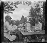 Agnes Whitaker, Mertie West, Forrest Whitaker, and William Shaw eating breakfast, Inyo County vicinity, about 1930