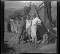 H. H. West Jr., Mertie West, and H. H. West pose together at a campsite, Inyo Couny vicinity, about 1930