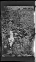 H. H. West fishing in Pine Creek, Inyo County vicinity, about 1930