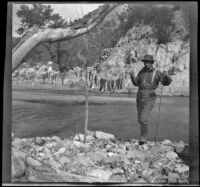 H. H. West posing with a string of fish, Los Padres National Forest vicinity, about 1917