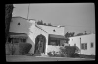 Mertie West leaving the residence of Dr. William B. Greenburg, Pomona, 1942