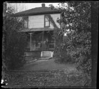 Ed Smith stands on the porch of the ranch house, Pomona, about 1895