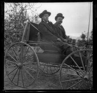 Bim Smith and Frank Baynham sitting in a buggy, Pomona, about 1895