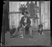 Bim Smith posing while cleaning a rabbit, Pomona, about 1895
