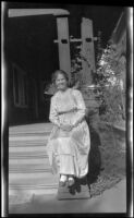 Mertie Whitaker sitting by the front porch of the West residence, Los Angeles, about 1915