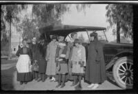 Caroline Lemberger, Wayne West, Wilson West, Mary West, Wilhelmina West, Frances West, Maud West, Elizabeth West, and Nella West pose in front of a car, Redlands, about 1916