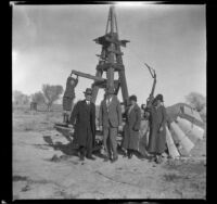 H. H. West, Jr., Abraham Whitaker, Forrest Whitaker, Mertie West and Agnes Whitaker posing by a windmill, Rosamund, about 1927