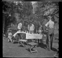 Members of the West, Whitaker and Shaw camping party standing around their camp, Modoc County, 1929