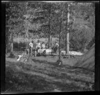 Members of the West, Whitaker and Shaw party standing in the distance around their campsite, Modoc County, 1929
