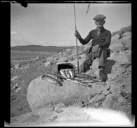 Abraham Whitaker poses with trout caught in Grant Lake, Mono County vicinity, 1929