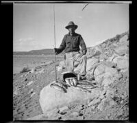 H. H. West poses with trout he caught in Grant Lake, Mono County vicinity, 1929
