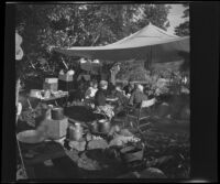 Josie Shaw, Mertie West, Forrest Whitaker and Agnes Whitaker sitting down to a meal in their camp, Mono County, 1941