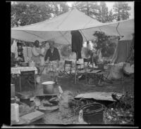 Josie Shaw and Mertie West standing beneath their camp's canopy, Mono County, 1941