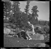 Mertie West sitting on a rock, Mono County, 1941