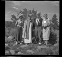 """Mertie West, Josie Shaw, Forrest Whitaker and Agnes Whitaker posing in their """"formal"""" attire, Mono County, 1941"""