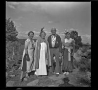 "Agnes Whitaker, Josie Shaw, Forrest Whitaker and Mertie West posing in their ""formal"" attire, Mono County, 1941"