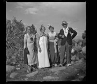 "Agnes Whitaker, Josie Shaw, Mertie West and H. H. West posing in their ""formal"" attire, Mono County, 1941"