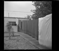 Towels and sheets hanging from a clothesline in the West's back yard, [Los Angeles], 1941