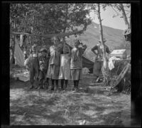 Lynn McClellan, Chester Schmitz, Elizabeth West, Irene Schmitz and Frances West posing in the Silver Lake camp, June Lake vicinity, 1914