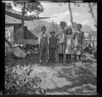 Lynn McClellan, Chester Schmitz, Elizabeth West, Irene Schmitz and Frances West posing at the Silver Lake campsite, June Lake vicinity, 1914