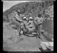 H. H. West, Frances West, Irene Schmitz, Elizabeth West and Albert Schmitz posing with fish, June Lake vicinity, 1914