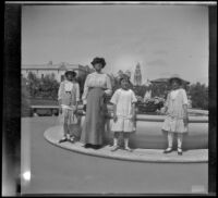 Elizabeth West, Minnie West, Frances Cline and Frances West posing in front of a fountain in Balboa Park, San Diego, [about 1915]