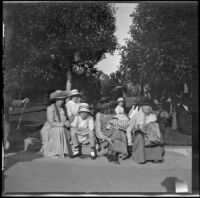 Members of the West and Schmitz families taking a break while visiting Balboa Park, San Diego, [about 1915]