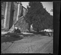Women walking near the old stairs at San Gabriel Mission, San Gabriel, about 1896
