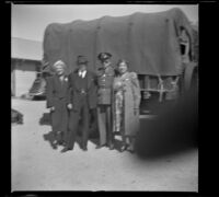 H. H. West poses with his wife and children at the Southern Pacific Railroad depot, San Luis Obispo, 1942