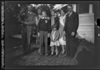 H. H. West's family poses in front of Wayne West's home, Santa Ana, about 1932