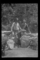 Glen Velzy and Nina Meyers pose in front of a stone wall, San Gabriel Mountains, 1941