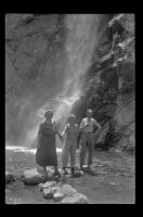 Nina Meyers, Mertie West and Glen Velzy stand in front of Sturtevant Falls, San Gabriel Mountains, 1941