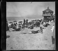 People on the beach with the camera obscura in the background, Santa Monica, about 1895
