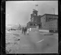 People walk on the boardwalk in front of the North Beach Bath House, Santa Monica, about 1895